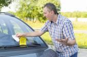 Man looking on parking ticket — Stock Photo