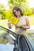 Woman holding parking ticket — Stock Photo