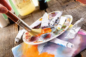 Artist hand painting — Stock Photo