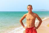 Man standing on the beach — Stock Photo