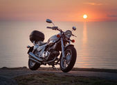 Motorbike in a sunset — Stock Photo