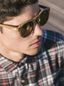 Model man portrait with wooden sunglasses — Stock Photo