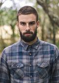 Hipster man portrait outdoors. — Stok fotoğraf