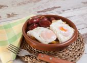 Eggs with french fries and small sausages. — Stock Photo