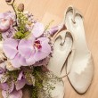Shoes and flowers — Stock Photo #67270025