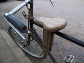 Wooden seat on a bike. — Stock Photo