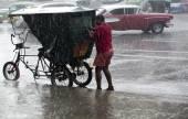 Rickshaw under a rainfall. — Stock Photo