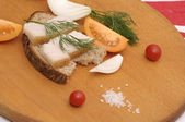 Sandwich with salted lard, onion and tomatoes — Stock Photo