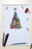 Christmas greeting card made of stationery — Stock Photo