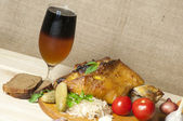 Roasted pork leg served with sauerkraut and sliced beer — Stock Photo