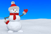 Snowman with scarf on snow pointing to copy-space — Stock Photo