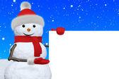 Snowman shows blank white board under snowfall — Stock Photo