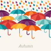 Autumn background with umbrellas in flat design style. — Vector de stock