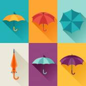 Set of cute multicolor umbrellas in flat design style. — Stock Vector