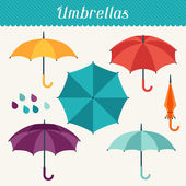 Set of cute multicolor umbrellas in flat design style. — Vector de stock