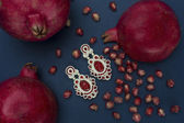 Soutache bijouterie Soutache bijouterie earrings with red stones — Stock Photo