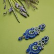 Soutache bijouterie blue earrings with green cyan and blue crystals — Stock Photo #60997121