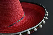 Mexican sombrero red on a black background — Stock Photo