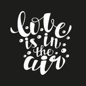 Hand lettering calligraphic typography poster 'Love is in the air' — Stock Vector