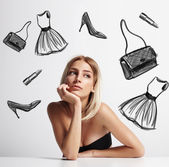 Woman thinking about shopping — Stock Photo