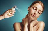 Perfume spray on woman neck — Stock Photo