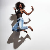 Jumping and screaming woman — Stock Photo