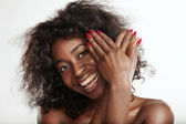 Woman hiding behind hands — Stock Photo
