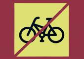 Photo of a bicycles using restriction sign with yellow backgroun — Stock Photo