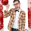 Composite image of geeky hipster in party hat pointing — Stock Photo #53894673