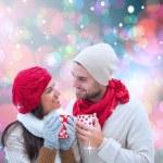 Winter couple holding mugs — Stock Photo #53894779
