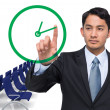 Serious asian businessman pointing to clock — Stock Photo #53895157