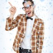 Composite image of geeky hipster in party hat pointing — Stock Photo #53895879