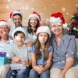 Family in christmas hats with gift boxes — Stock Photo #53896089