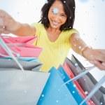 Young woman showing shopping bags — Stock Photo #53896533