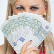 Green eyed woman holding 100 euros banknotes — Stock Photo #53896537