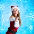 Composite image of sexy santa girl blowing a kiss — Stock Photo #53896629
