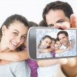 Smiling young family looking at camera — Stock Photo #53896733