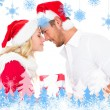 Festive young couple exchanging presents — Stock Photo #53897023