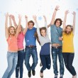 Celebrating friends jumping in the air — Stock Photo #53897183