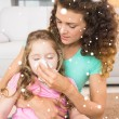 Mother helping daughter blow nose — Stock Photo #53897433