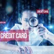 Word credit card and businesswoman typing — Stock Photo #53897537
