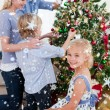 Family decorating Christmas tree — Stock Photo #53897753
