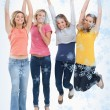Smiling celebrating girls jumping up — Stock Photo #53898425