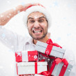 Stressed festive man holding gifts — Stock Photo #53898483