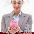 Young businesswoman holding a piggy bank — Stock Photo #53898661