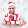 Festive man holding christmas gift — Stock Photo #53898689