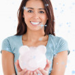 Lovely woman posing with a piggy bank — Stock Photo #53898949