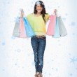 Beaming woman student with shopping bags — Stock Photo #53899113