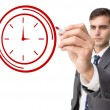 Businessman drawing clock — Stock Photo #53899451