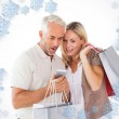 Happy couple holding shopping bags — Stock Photo #53899461